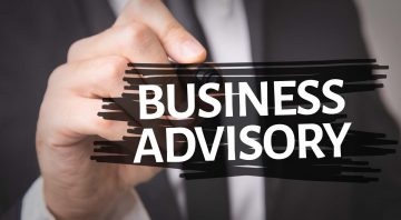 business advisory services written on a glass pane